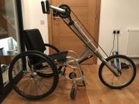 A Cyclone MTM sports wheelchair and a Tracker 7 speed hand bike